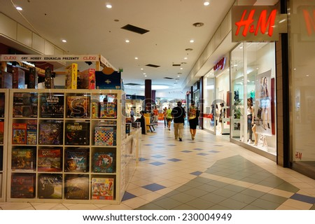 POZNAN, POLAND - AUGUST 10, 2013: People by a H&M store in the shopping mall King Cross - stock photo