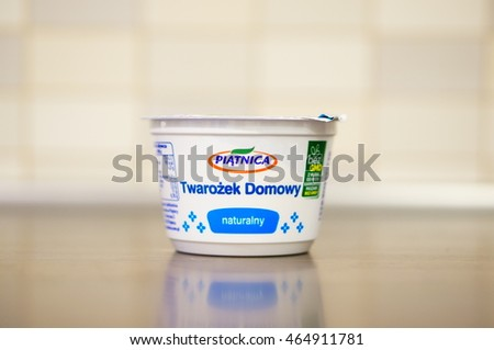 POZNAN, POLAND - AUGUST 07, 2016: Polish Piatnica natural cottage cheese in a plastic cup