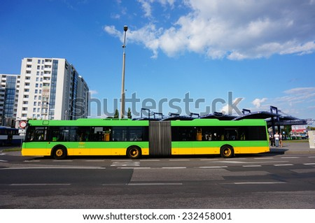 POZNAN, POLAND - AUGUST 29, 2013: Public transport bus waiting in front of the Rataje station - stock photo