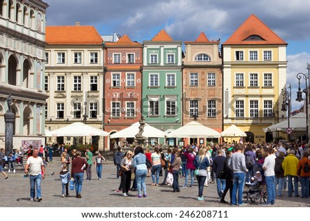 POZNAN, POLAND - AUGUST 20: The colorful main square and town hall in Poznan on August 20, 2014 in Poznan, Poland. The city is the 4th largest and the 3rd most visited city in Poland. - stock photo