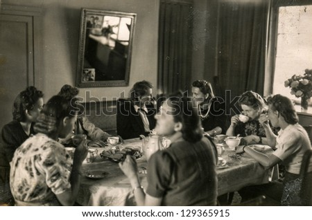 POZNAN, POLAND - CIRCA 1936: a group of unidentified young women is drinking tea during a tea party, circa 1936 in Poznan, Poland