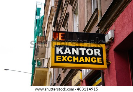 POZNAN, POLAND - DECEMBER 28, 2013: Currency exchange sign on a building in the city