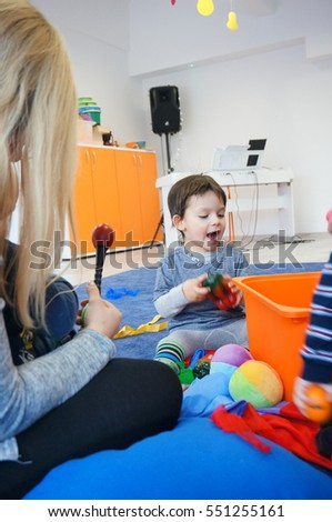 POZNAN, POLAND - JANUARY 07, 2017: Unidentified boy using plastic instruments during classes of a music school