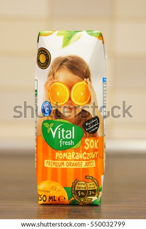 POZNAN, POLAND - JANUARY 05, 2017: Vital Fresh orange juice for kids in a small pack on table
