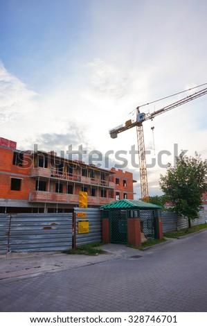 POZNAN, POLAND - JULY 11, 2015: Building under construction and crane at the Stare Zegrze area