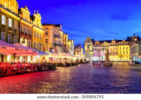 POZNAN, POLAND - JULY 5: Main square of the old town of Poznan on a summer day evening. Poznan is one of the main tourist destinations of Poland. Poznan, Poland on July 5, 2015 - stock photo