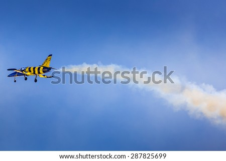 "POZNAN, POLAND - JUNE 14: Aerobatic group formation ""Baltic Bees"" at blue sky during Aerofestival 2015 event on June 14, 2015 in Poznan, Poland"