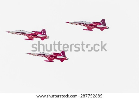 """POZNAN, POLAND - JUNE 14: Aerobatic group formation """"Turkish Stars"""" at blue sky during Aerofestival 2015 event on June 14, 2015 in Poznan, Poland - stock photo"""