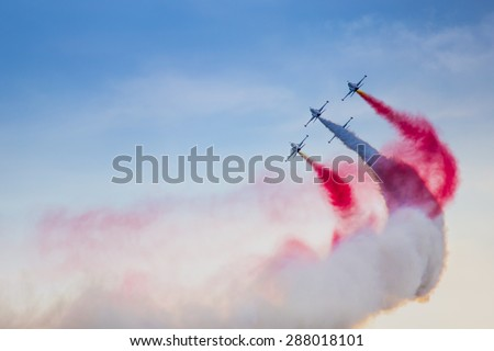 "POZNAN, POLAND - JUNE 14: Aerobatic group formation ""Turkish Stars"" at blue sky during Aerofestival 2015 event on June 14, 2015 in Poznan, Poland - stock photo"