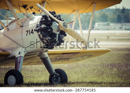 POZNAN, POLAND - JUNE 14: Boeing Stearman 1930s US training aircraft during Aerofestival 2015 event on June 14, 2015 in Poznan, Poland - stock photo