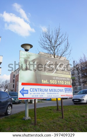 POZNAN, POLAND - MARCH 28, 2016: Billboard showing the way to a La Folie beauty salon and Bazar furniture store at the Stary Zegrze area