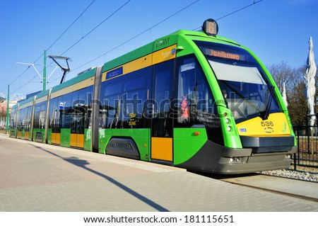 POZNAN, POLAND - MARCH 8, 2014: introduced in 2010, streetcar Tramino is a product of Solaris Bus & Coach, bus, coach, trolleybus and tram manufacturer based in Bolechowo near Poznan, Poland - stock photo