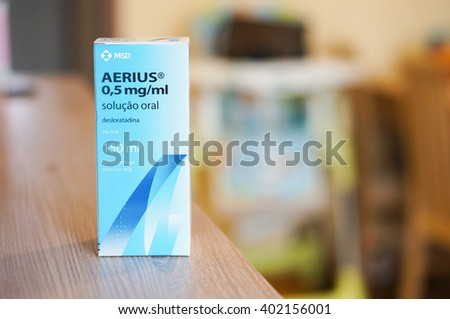 POZNAN, POLAND - MARCH 25, 2016: MSD Aerius anti allergy syrup medicine in a box on table - stock photo