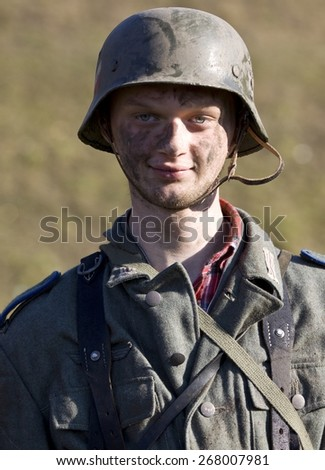 POZNAN, POLAND - MARCH 23, 2014: Re-enactment of the battle of the World War II. Anniversary of the liberation of the city of Poznan. In the picture one of the actors. - stock photo