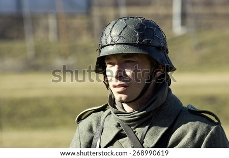 POZNAN, POLAND - MARCH 23, 2014: Re-enactment of the battle of the World War II. Anniversary of the liberation of the city of Poznan. In the picture one of the actors.