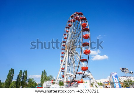 POZNAN, POLAND - MAY 10, 2016: High ferris wheel on a luna park  - stock photo