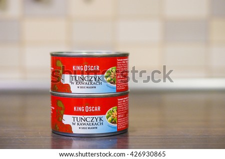 POZNAN, POLAND - MAY 16, 2016: King Oscar tuna fish pieces on a can standing on table - stock photo