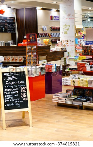 POZNAN, POLAND - NOVEMBER 26, 2013: Stacked books on shelfs in a book store - stock photo