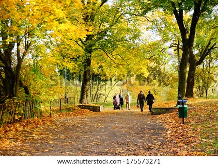 POZNAN, POLAND - OCTOBER 20, 2013: People walking at a park in the autumn season