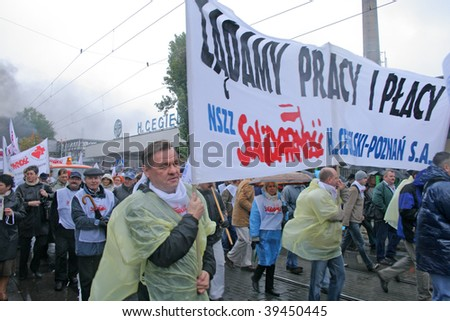 POZNAN, POLAND - OCTOBER 23: Polish 'Solidarnosc' workers from H.Cegielski factory and shipyards on manifestation over pay, unemployment and recession on October 23, 2009 in Poznan, Poland. - stock photo