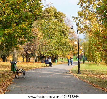 POZNAN, POLAND - OCTOBER 20, 2013: Walking and sitting people at the Citadel park
