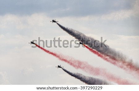 POZNAN, POLAND -SEP 23, 2015: The Turkish Stars are the aerobatic demonstration team of the Turkish Air Force and the national aerobatics team of Turkey. - stock photo