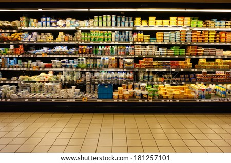 POZNAN, POLAND - SEPTEMBER 05, 2013: Cooling with many milk products in a supermarket - stock photo