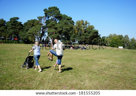 POZNAN, POLAND - SEPTEMBER 07, 2013: People resting at a park on a sunny day