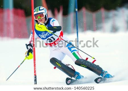 POZZA DI FASSA, ITALY - DECEMBER 30: Unidentified participant of ski race performs at Italian Slalom Championship on December 30, 2012, Pozza di Fassa, Italy - stock photo