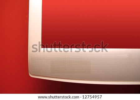 Pplasma TV with transparent screen on red wall.