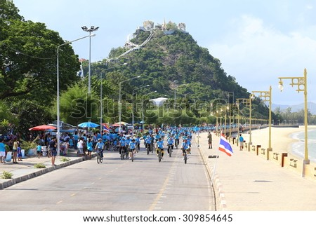 "PRACHUAP KHIRI KHAN AUGUST 16:Unidentified cyclists at ""Bike for mom""event show respected to Queen of Thailand by the participant cycling, on August 16, 2015, Prachuap khiri khan,Thailand."
