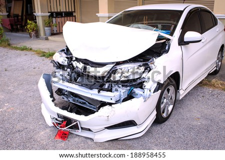 PRACHUAP KHIRI KHAN, THAILAND - APRIL 15 : Front side of white private car damaged after get heavy on the highway road accident on April 15, 2014 in Prachuap Khiri Khan, Thailand. - stock photo