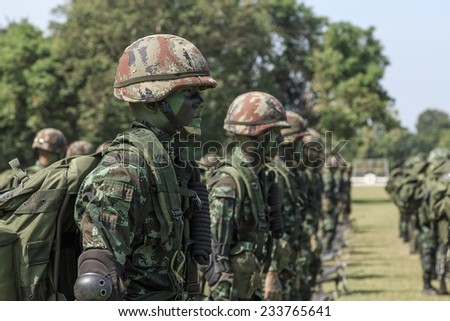 "PRACHUAP KHIRI KHAN, THAILAND - NOV 24, 2014: Unidentified soldier standing in the line opening ceremony of maneuver in ""The Ultimate Soldier"" 72 hours battle operation of Thai Royal Army, THAILAND. - stock photo"
