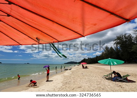 PRACHUAPKHIRIKHAN, THAILAND - SEP 9 : Unidentified tourists vacation on a beach at Suan Son Pradipat Beach, Hua Hin on September 9, 2011 in Prachuapkhirikhan, Thailand - stock photo