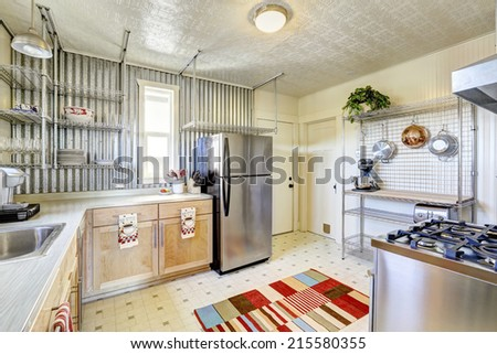 Practical design of kitchen room with steel racks. Steel appliances and light tone storage cabinets - stock photo