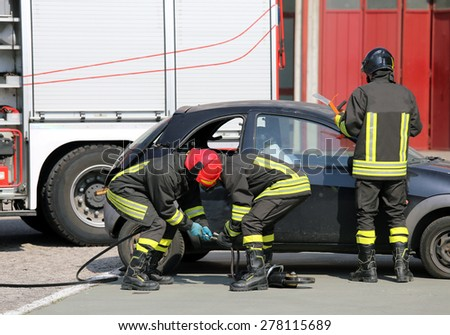 practice of firefighters in the Firehouse and simulation of traffic accident - stock photo