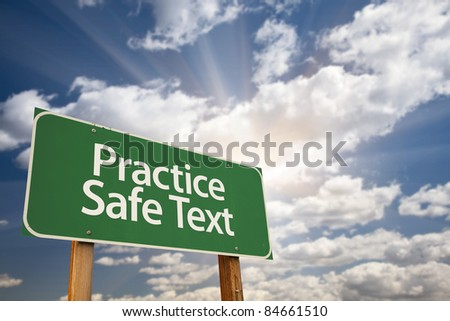 Practice Safe Text Green Road Sign with Dramatic Sky, Clouds and Sun.