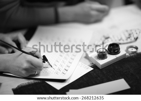 Practicing beautiful writing - stock photo