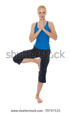Practicing Yoga. Young woman isolated on white background - stock photo