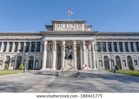 Prado Museum facade and Cervantes statue in Madrid, Spain - stock photo