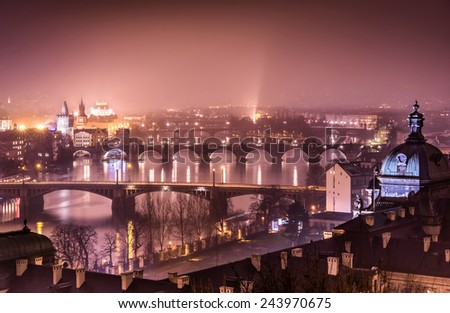 Prague and Vltava river from Letna Hill - Romantic view after misty sunset with emotional marsala color filter - European capital of bohemian Czech Republic - stock photo