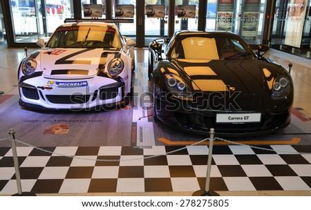 PRAGUE - APRIL 14: Porsche Carrera GT and Porsche 911 991 GT3. Czech republic, April 14, 2015 - stock photo