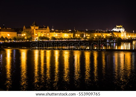 Prague architecture and Vltava river night view, Czech Republic.