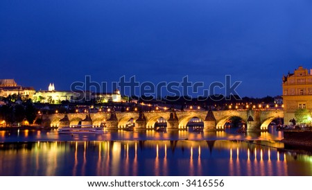 Prague at dusk with lights on - stock photo