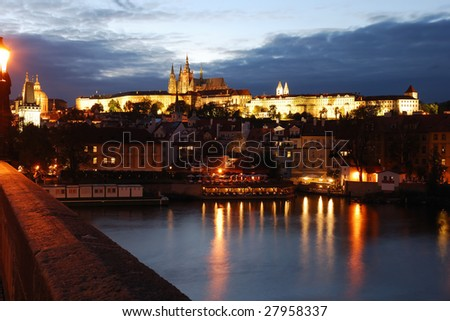 Prague at night with lights on, view of karlovy bridge