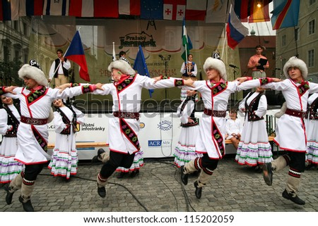 PRAGUE - AUGUST 26: Unknown people dance in traditional costumes at Folklore Festival Prague Fair, 25-30.8.2009, close to the Old Town Square on August 26, 2009 in Prague, Czech Republic