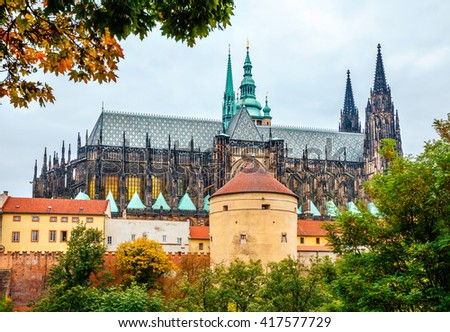 Prague autumn landscape view to saint vitus cathedral. Castle of old city tower with trees. - stock photo