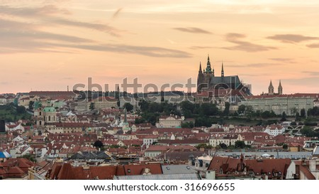 Prague Beautiful Panorama Aerial View of Old Town Skyline Landmark St. Vitus Cathedral, Prague Castle and Prague under golden Sunset sky Twilight at Dusk in Summer, Czech Republic  - stock photo