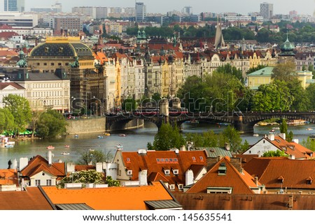 Prague buildings along Vltava river as seen from Prague Castle - stock photo