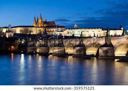 Prague caste and the Charles bridge at dusk - stock photo